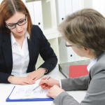 Career coach is coaching Job applicant for interview.